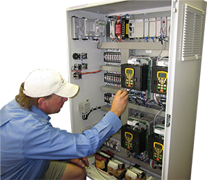 Technician Servicing a control panel